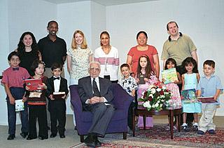 Mr. Furutan with children and their teachers, June 2003.